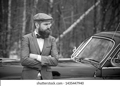 Travel and business trip or hitch hiking. Retro collection car and auto repair by mechanic driver. Call boy in vintage auto. Bearded man in car. Escort man or security guard.
