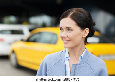 travel, business trip, people and tourism concept - smiling young woman over taxi station or city street