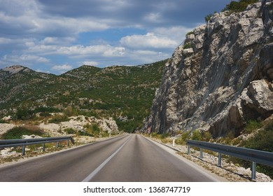 Travel by car. Good asphalt road in the mountains. Trip to Europe, the Mediterranean and the Balkans. Roads and landscapes of Montenegro, mountains and valleys.