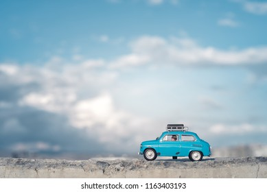 Travel by car with luggage on the roof