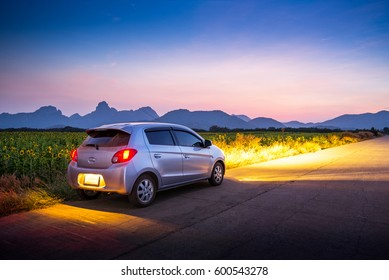 Travel car with sunset and landscape view.