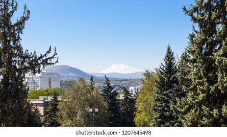 travel to Caucasian Mineral Waters region - view of snow-covered top of Mount Elbrus from Pyatigorsk city in autumn morning
