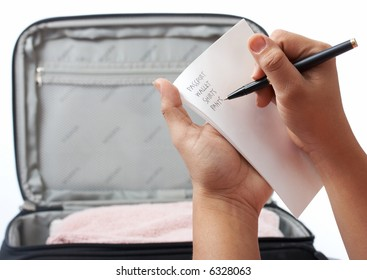 a travel checklist with a travel bag on the background