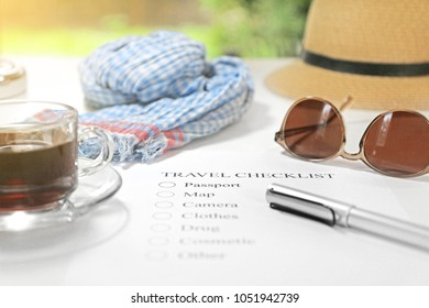 Travel checklist on table.