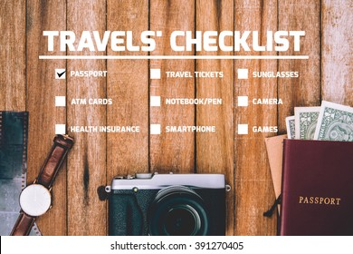 Travel Checklist for Preparing for a Trip, mobile phone, money, passport, camera, pencil ,eyeglass, book, Watch, in vintage color on wooden table Checklist.