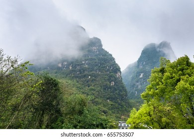 travel to China - clouds over of karst mountains in Yangshuo County in spring season