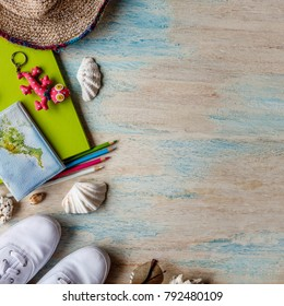 Travel concept background. Overhead view of traveler's accessories. Sneakers, passport, notebook, colored pencils, key ring, shells, hat, sunglasses. With space. Square image.