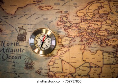 Travel concept background, vintage compas and old earth map