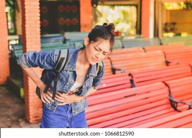 Travel Concept. Beautiful girl is having severe stomach pain while traveling. Asian women are not comfortable while traveling.