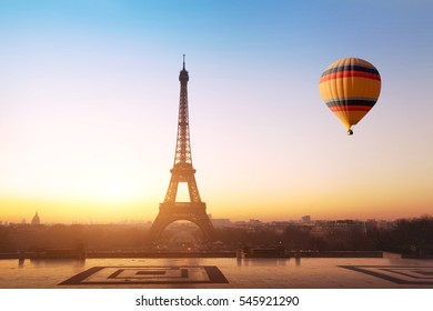 travel concept, beautiful view of hot air balloon flying near Eiffel tower  in Paris, France, tourism in Europe