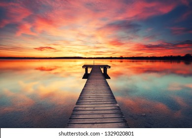 travel concept - beautiful view on the sea with sunset and jetty