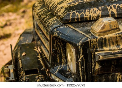 Travel concept with big 4x4 car. Track on mud. 4x4 Off-road suv car. Offroad car. Safari. Off-road travel on mountain road. Best Off Road Vehicles