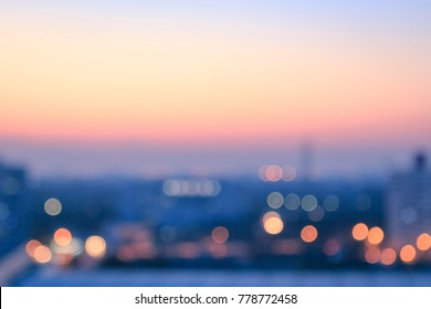Travel concept: Bokeh light and blur city skyline autumn sunrise background