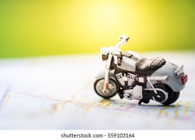 Travel Concept. Close up of motorcycle toy on map with daylight