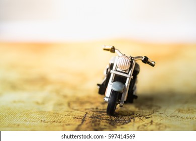 Travel Concept. Close up of motorcycle toy on map.