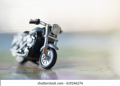 Travel Concept. Close up of motorcycle toy on map with copy space