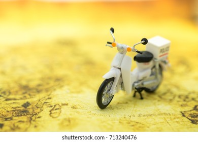 Travel Concept. Close up of vintage motorcycle toy on map.