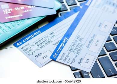 travel concept with credit cards and flight tickets on laptop