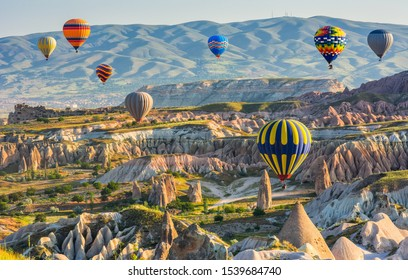 Travel concept. The great tourist attraction of Cappadocia - balloon flight. Cappadocia one of the best places in the world to fly with hot air balloons. Goreme, Cappadocia, Turkey. Beauty world.