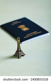 travel concept , Indian passport with Eiffel tower miniature