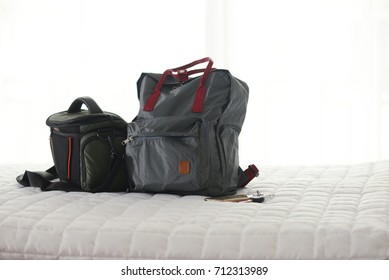 Travel concept. Luxury room with bag and bed.
