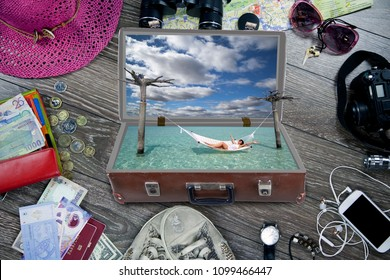 Travel concept. Overhead view of Traveler's accessories, Essential vacation items, sneakers, binoculars, map, notepad, watch, phone, glasses, hat, passport, money;Collage with old dirty dusty suitcase