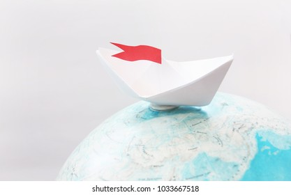 Travel concept with paper boat