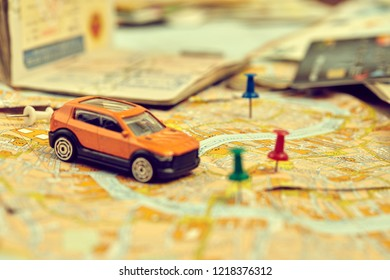 travel concept - small toy car on the map