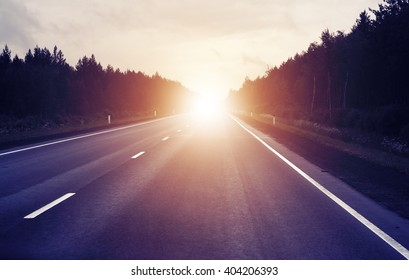 travel concept, sunrise on an empty road