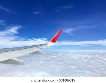 Travel concept, view of clouds from the window airplane with more cloud and blue sky.