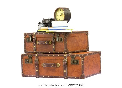 Travel concept - vintage traveling items - suitcases, clock, camera and books, isolated on white background