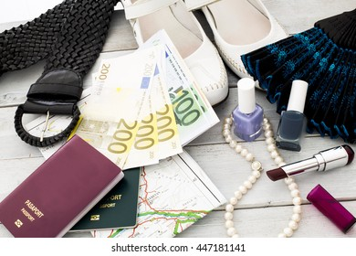 Travel concept. Woman accessories, straw hat, passport and money on wooden table