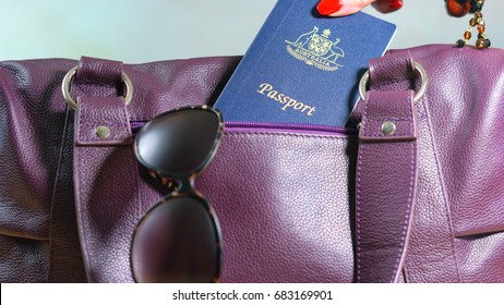 Travel concept with woman taking passport from carry bag.