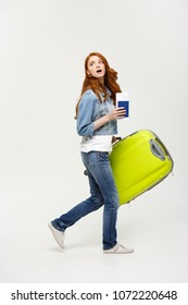 Travel Concept: young caucasian women holding green suitcase between go to the airport.
