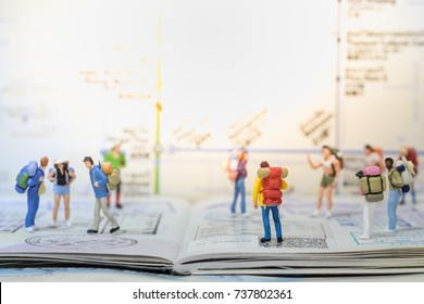 Travel concepts. Group of traveler miniature mini figures with backpack stand and walking on passport with immigration stamps with map as background