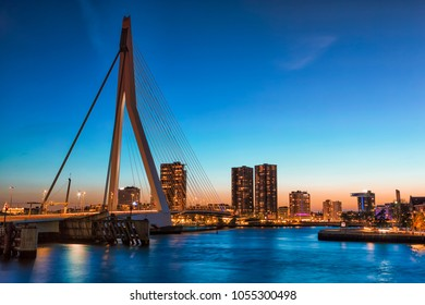 Travel Concepts and Ideas. Beautiful and Astonishing View of Rotterdam Skyline with  Erasmus Bridge on Foreground During Blue Hour. Horizontal Image Orientation
