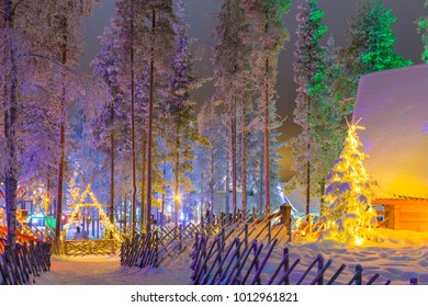 Travel Concepts and Ideas. Marvelous Lapland Houses in Suomi Village in Front of Marvelous Highlighted Winter Forest Scenery. Horizontal Image composition