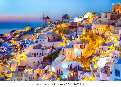 Travel Concepts. Skyline of Oia Town with Traditional White Architecture and Iconic Windmills in Village of Santorini in Greece.World Famous Resort.Horizontal Composition