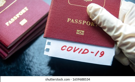 Travel and coronavirus concept, a note COVID-19 in tourist passport. Medical test at border control due to COVID. Business and tourism hit by corona virus, restrictions during coronavirus pandemic.