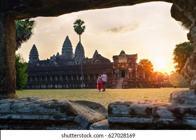Travel couple in Angkor Wat at sunrise moment, Siem Reap, Cambodia