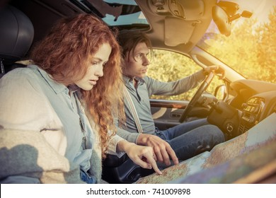 Travel. Couple in car, having a trip around the Europe