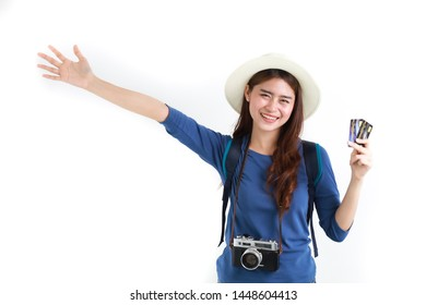 Travel with credit card concept : Asian woman in blue shirt and vintage camera happy and smile with credit card on white background