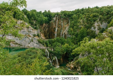 Travel to Croatia. Plitvice Lakes is a popular Croatian national park of incredible beauty. Photo of a favorite point among tourists - a stunning waterfall surrounded by greenery