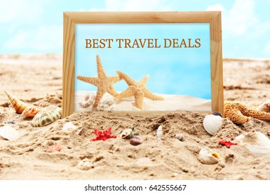 Travel deals concept. Photo frame and seashells on sand, closeup