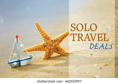 Travel deals concept. Starfish and little boat on seashore, closeup