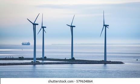 Travel to Denmark - turbines on island of offshore wind farm Middelgrunden in Oresund near Copenhagen city in Baltic Sea in blue autumn morning