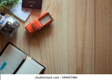 Travel desk or travel concept Tourist essentials. Plan a journey. Space for text copy space  and top view.