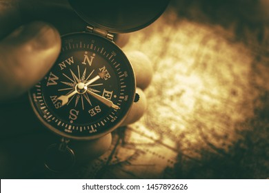 Travel Destination with Compass and Map Concept Photo. Sepia Color Grading.