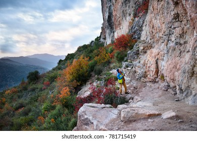 Travel destination, discover  Europe. Rock climbing region, rock climber choosing a sport route on a steep cliff. Adventure lifestyle.  Siurana, Spain.