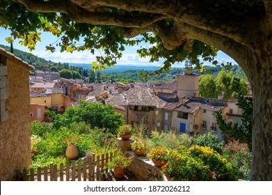 Travel destination, small ancient village Cotignac in Var, Provence, surrounded by vineyards and cliffs with troglodytes houses.